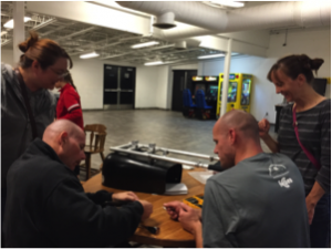 Players & Volunteers assembling sleds