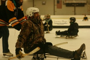 Jerry trying sled hockey for the first time